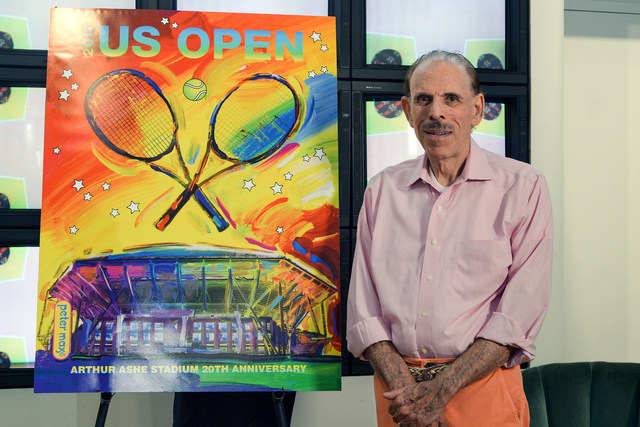 Peter Max poses with the artwork he created for the 20th anniversary of Arthur Ashe Stadium. Ashley Marshall/USTA