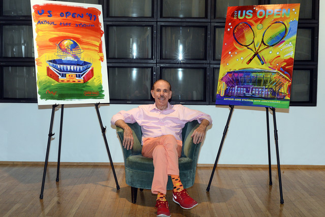 Artist Peter Max poses in his Manhattan Studio between the artwork he created for the 1997 US Open, the first year of Arthur Ashe Stadium, and the 2017 US Open. Ashley Marshall/USTA